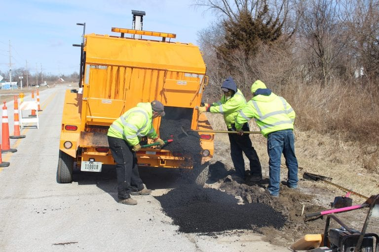 """Recycled asphalt """"cooked"""" into """"new"""" hot mix for small street repairs"""