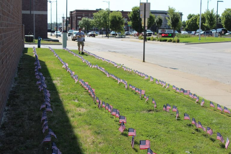 Muscatine Firefighter places 343 flags to honor 9/11 First Responders